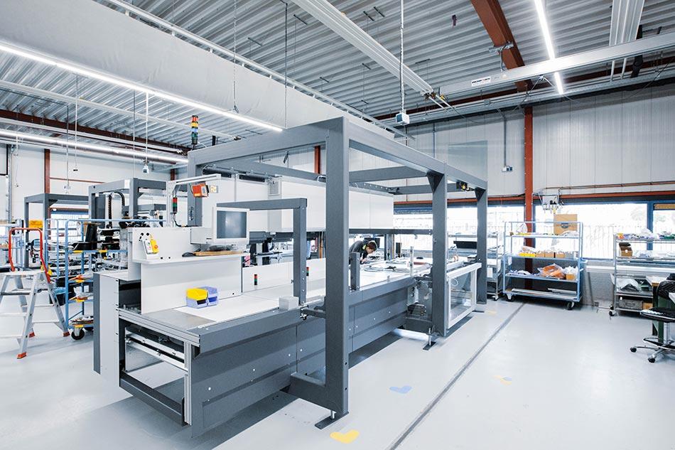 Referenz In-Haus-Foerdertechnik Neopost by KTR Systems GmbH